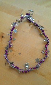 Twist the wire garland and beads together.