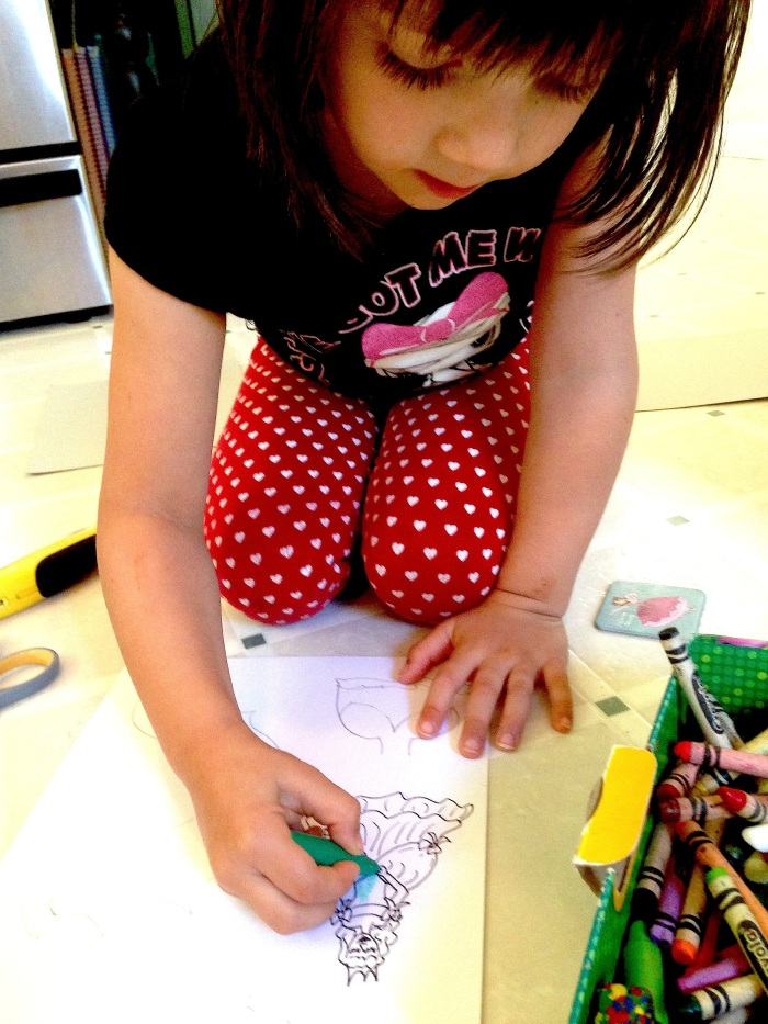 Elise coloring her princess.