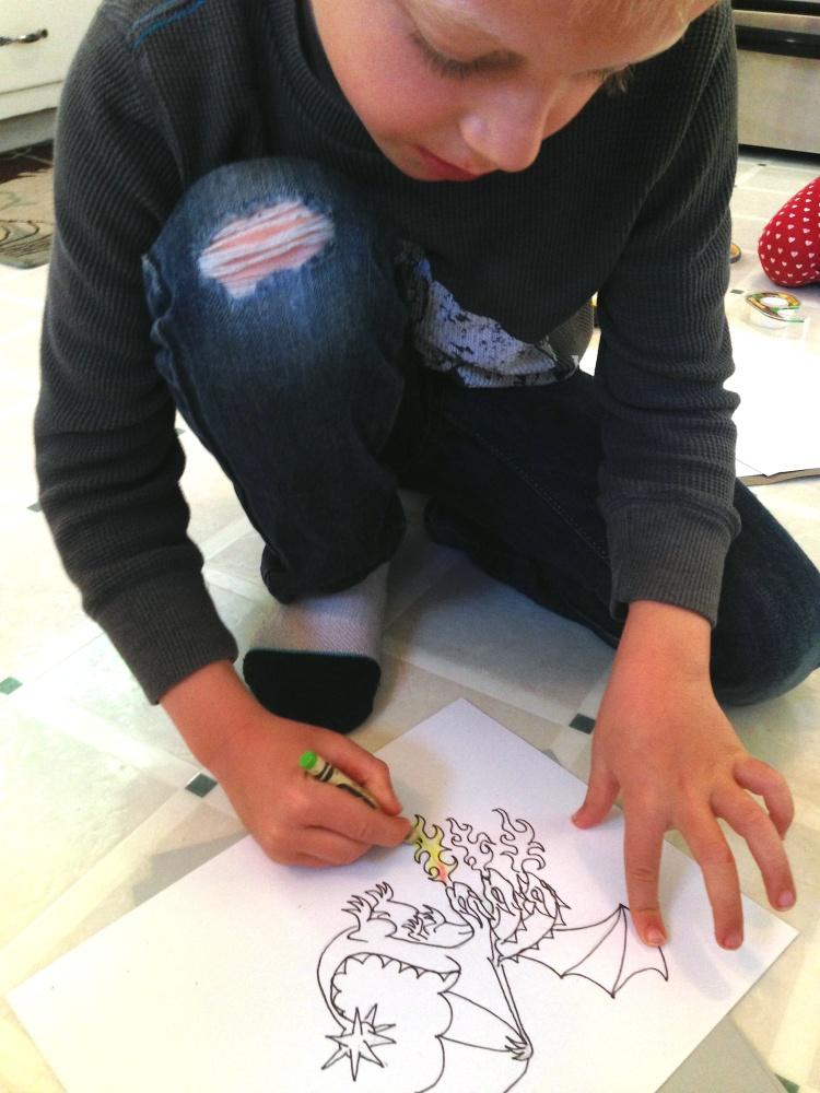 Jack coloring his dragon.