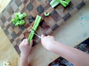 Chopping, a pairing knife works well for little hands.
